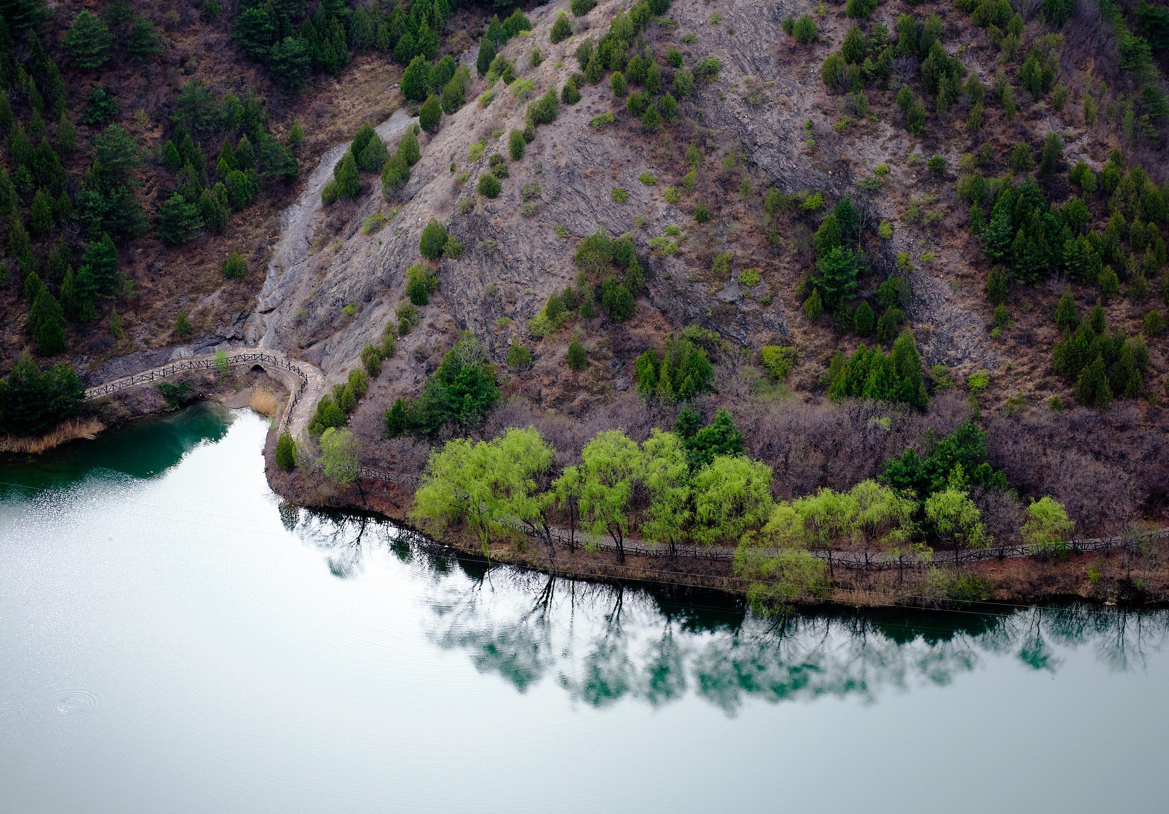 Reflection of trees in lake Gubei Watertown