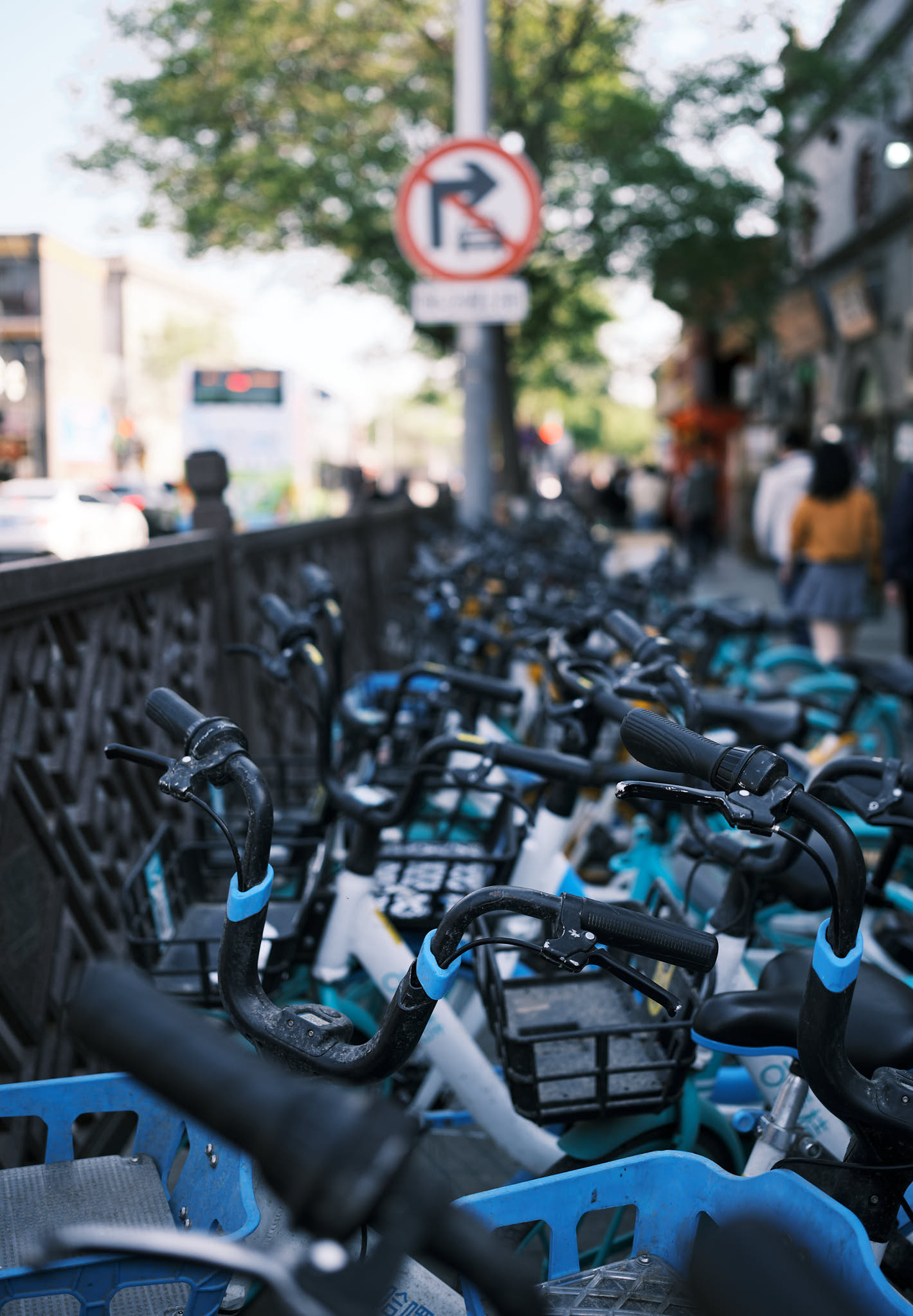 Shared rental bicycles litter the street in Qianmen