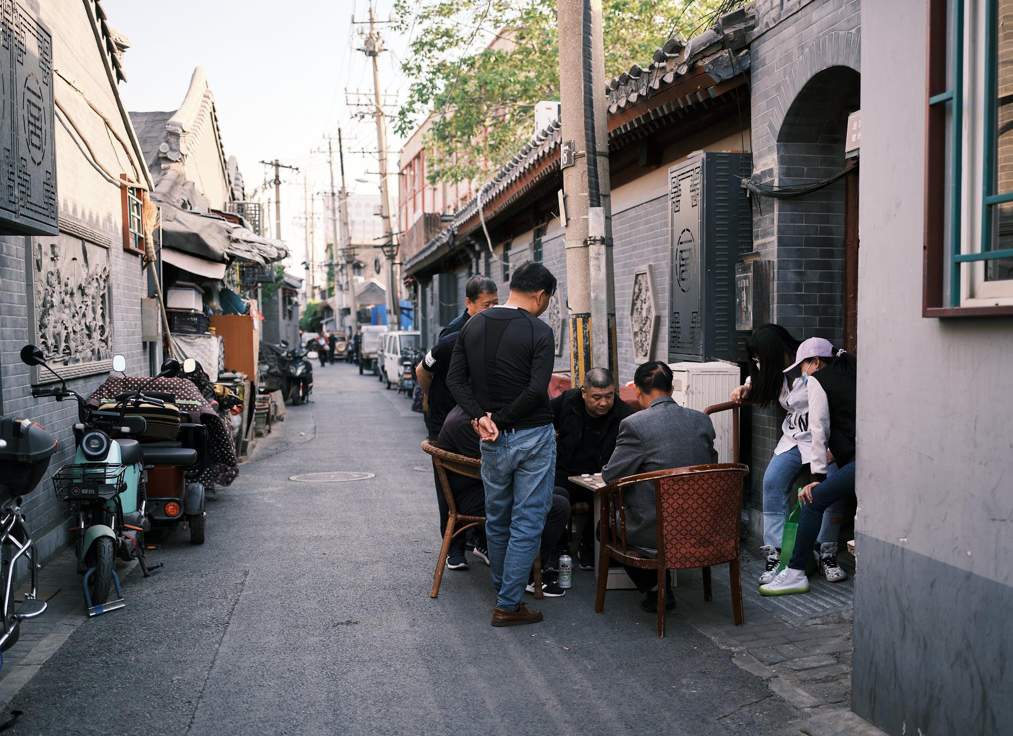 People playing games in Qianmen Hutong Beijing