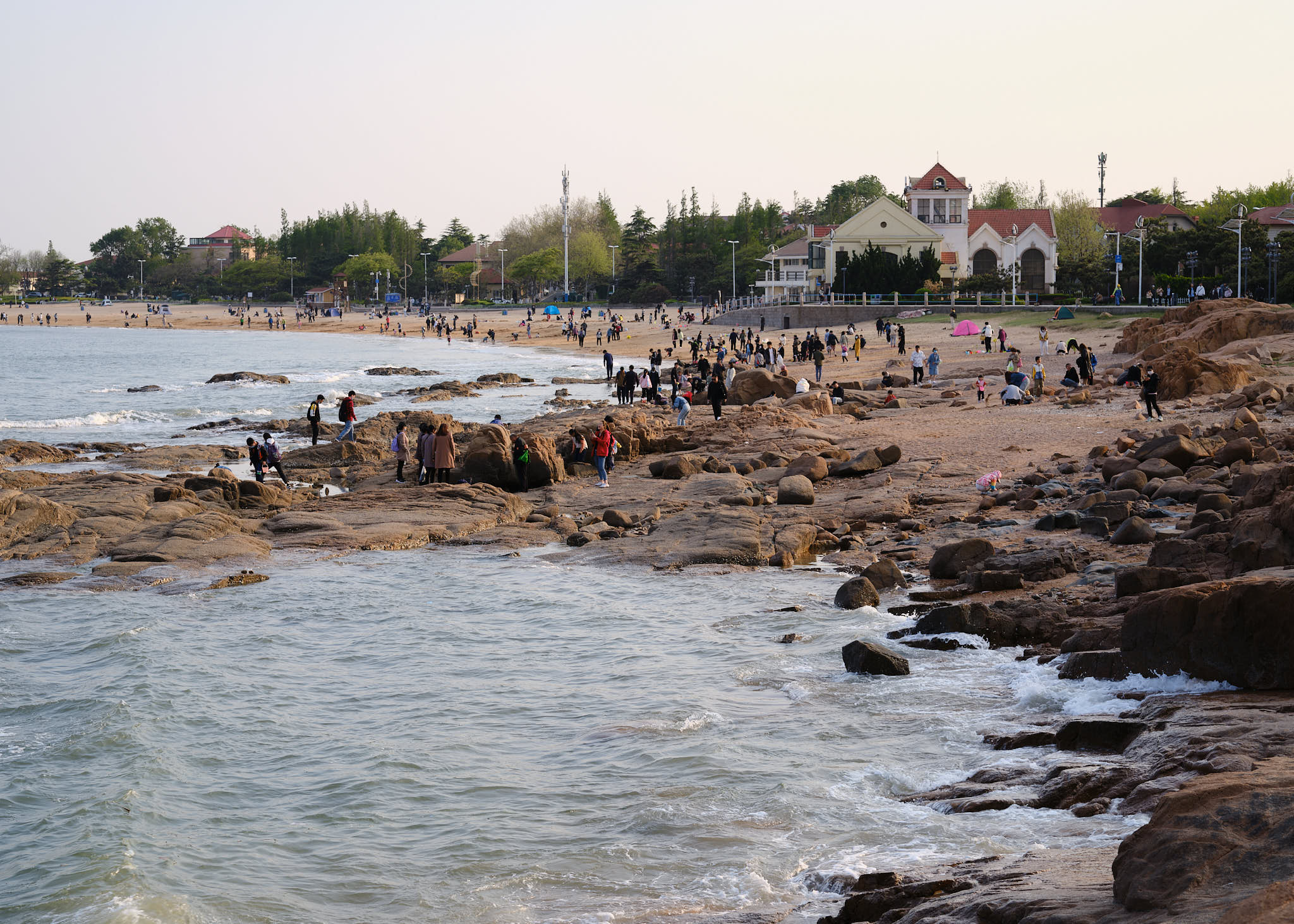 People hanging out at sunset at the beach in Qingdao