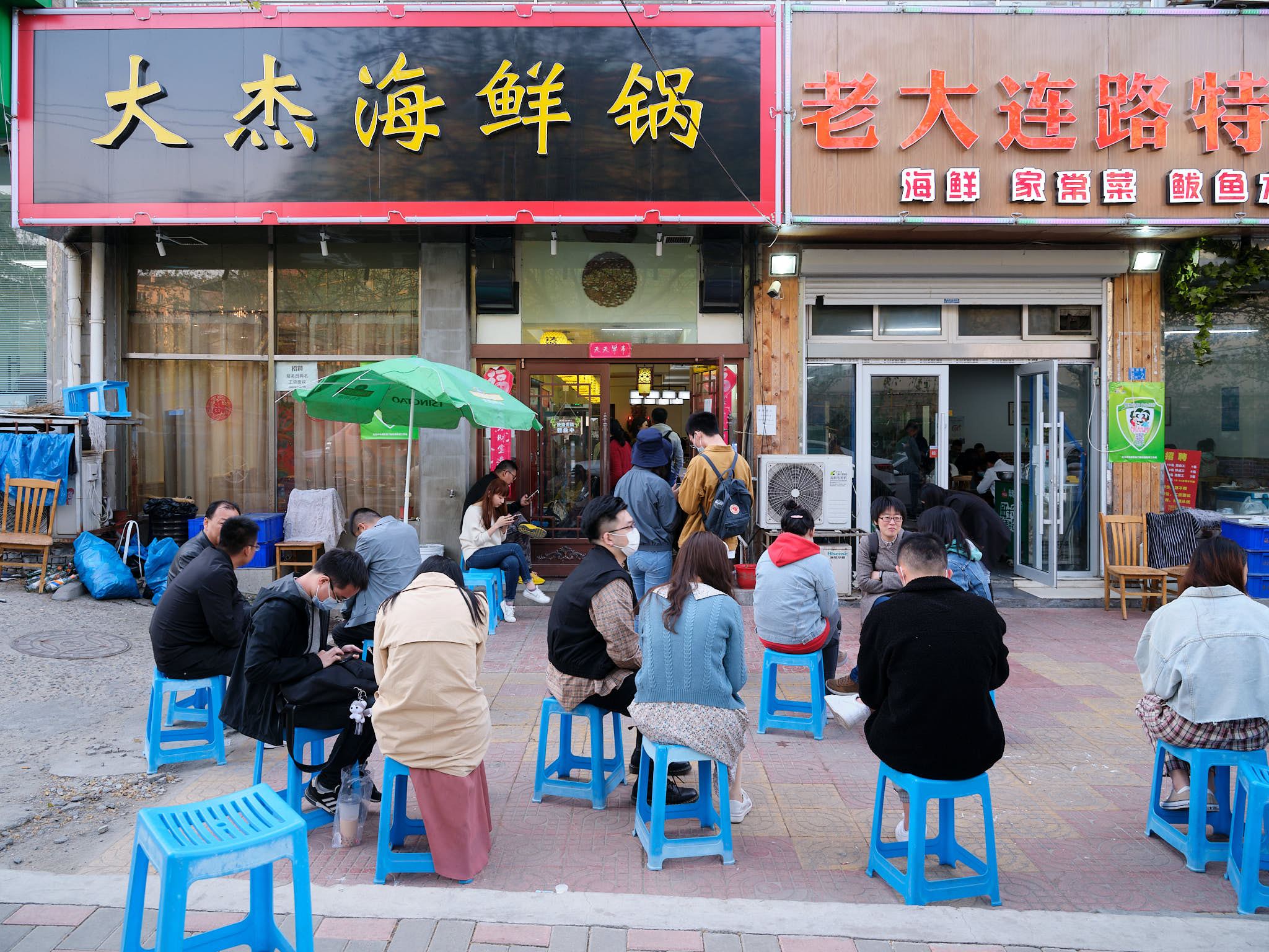 People waiting outside a famous seafood restaurant in Qingdao