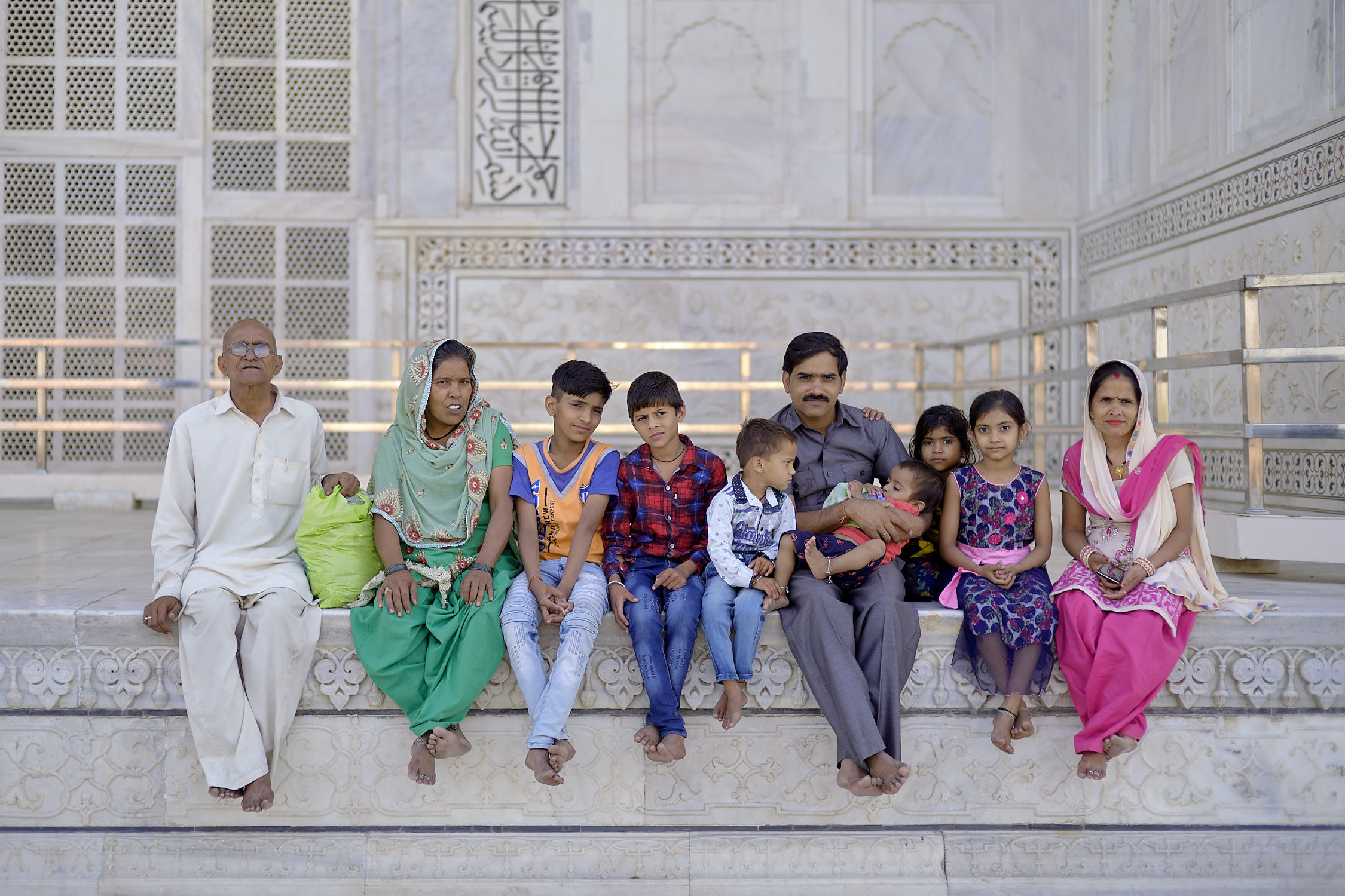 Family enjoying sunrise at Taj Mahal
